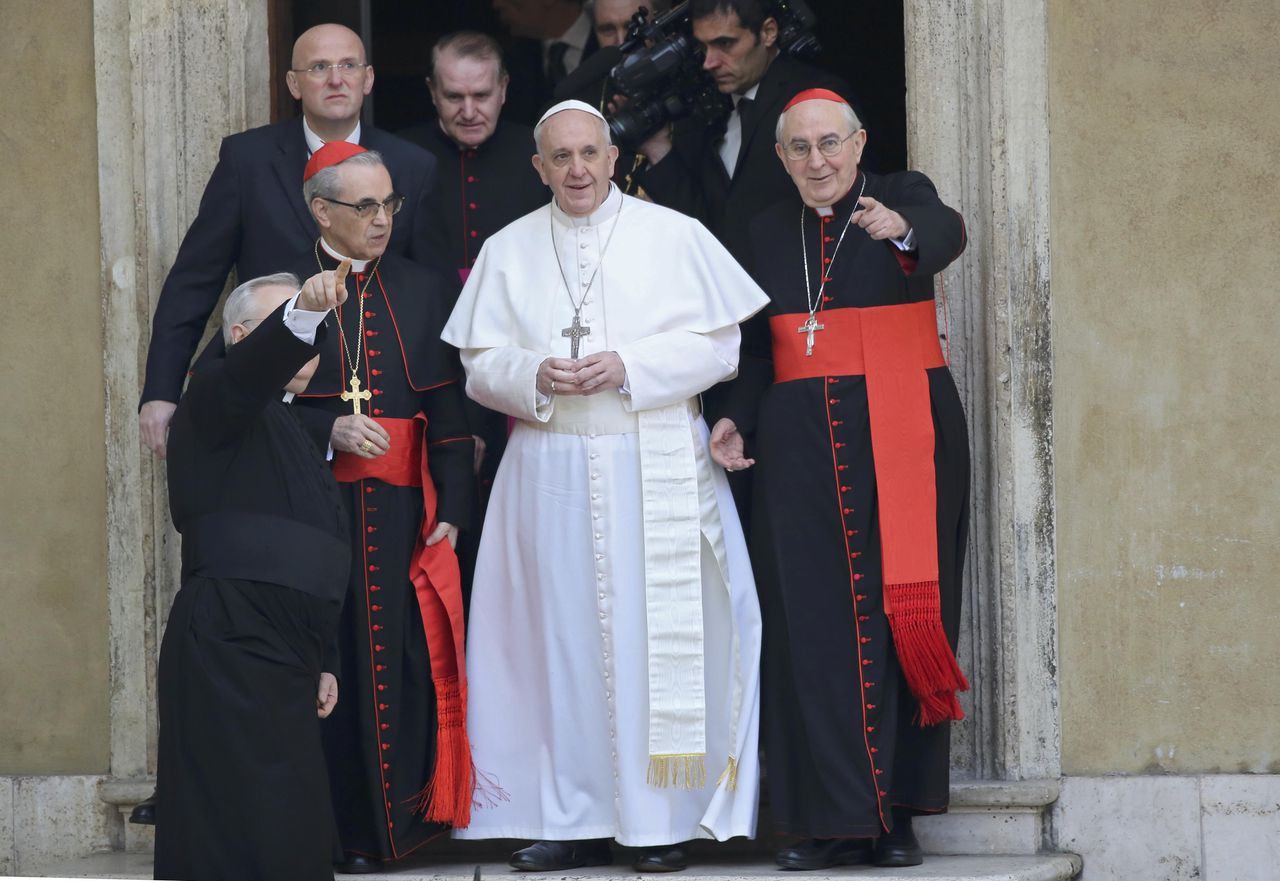 Newly elected Pope Francis, Cardinal Jorge Mario Bergoglio of Argentina waves from the steps of the Santa Maria Maggiore Basilica in Rome, March 14, 2013. At left is Cardinal Santos Abril of Spain and Cardinal Agostino Vallini, Vicar General of Rome at right. REUTERS/Alessandro Bianchi (ITALY - Tags: RELIGION POLITICS)