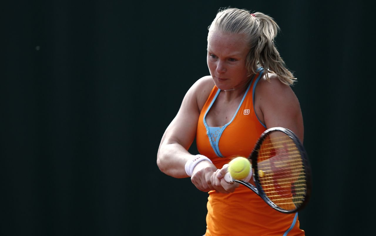 Netherlands' Kiki Bertens hits a backhand shot to Romania's Sorana Cirstea during a French tennis Open first round match on May 26, 2013 at the Roland Garros stadium in Paris. AFP PHOTO / THOMAS COEX