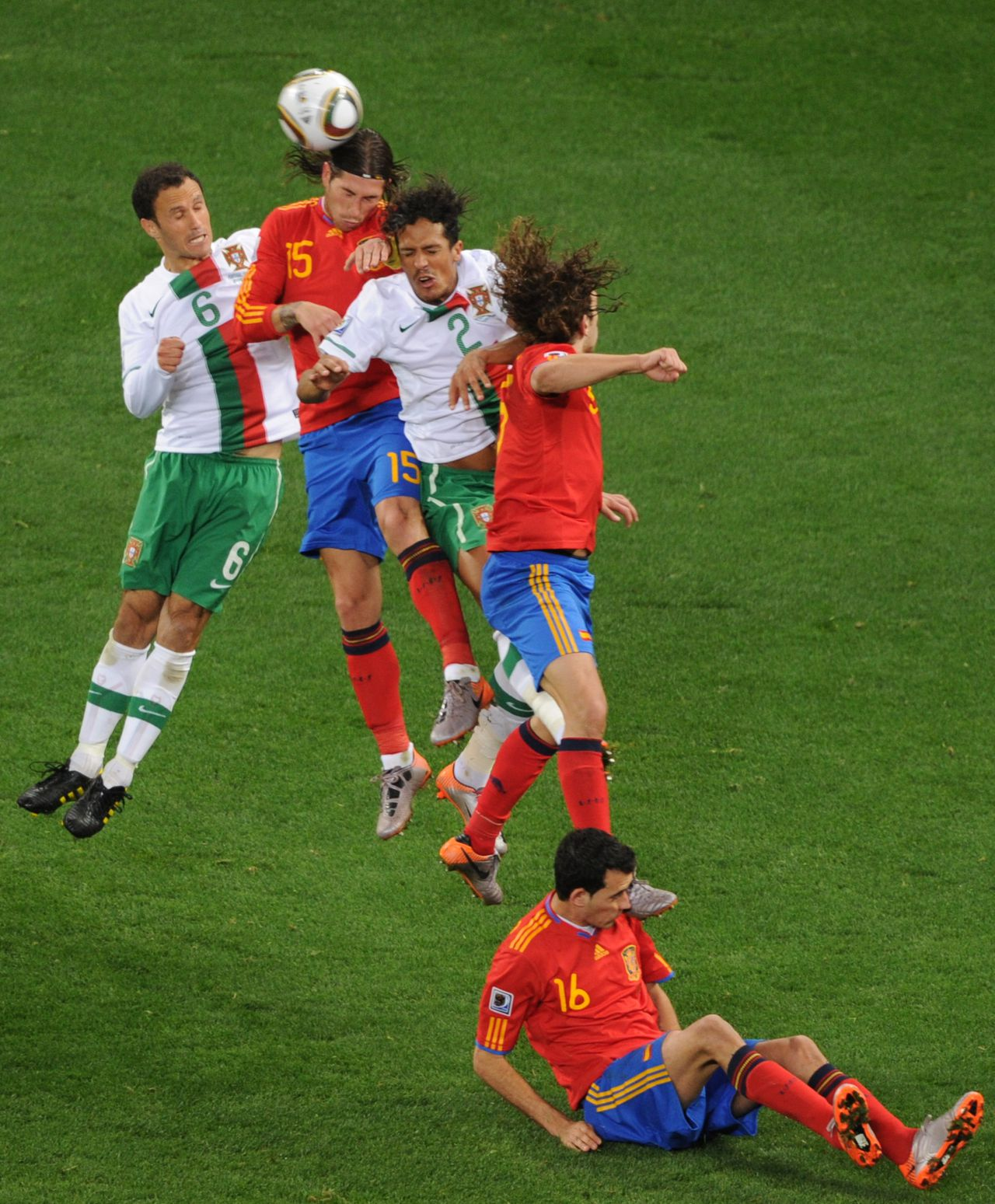 (From L) Portugal's defender Ricardo Carvalho, Spain's defender Sergio Ramos and Portugal's defender Bruno Alves fight for the ball during the 2010 World Cup Round of 16 football match between Spain and Portugal on June 29, 2010 at Green Point stadium in Capetown. NO PUSH TO MOBILE / MOBILE USE SOLELY WITHIN EDITORIAL ARTICLE = AFP PHOTO / CARL DE SOUZA