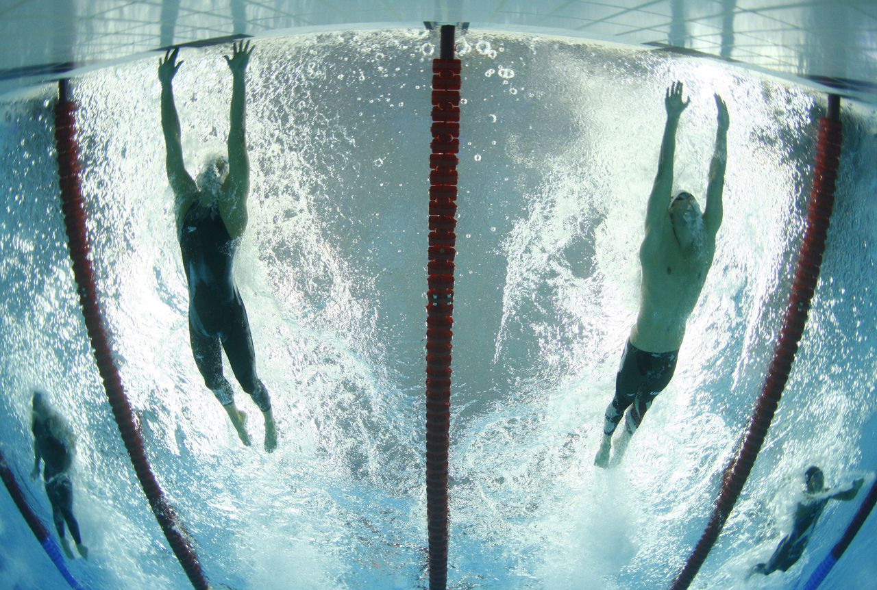 RNPS IMAGES OF THE YEAR 2008 Milorad Cavic (L) of Serbia touches the wall ahead of Michael Phelps (R) of the U.S. to win their men's 100 meters butterfly swimming heat at the National Aquatics Center during the Beijing 2008 Olympics August 14, 2008. REUTERS/Wolfgang Rattay (CHINA)