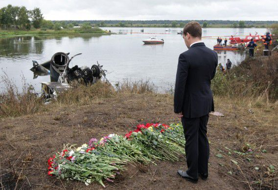 FILE - In this Thursday, Sept. 8, 2011 file photo, Russian President Dmitry Medvedev pays his last respects at a plane crash site near Yaroslavl, on the Volga River about 150 miles (240 kilometers) northeast of Moscow, Russia. The crash that killed 44, including an entire top ice hockey team, prompted Medvedev to suggest replacing all Soviet-era jets with Western planes. (AP Photo/Maxim Shipenkov, Pool, File)