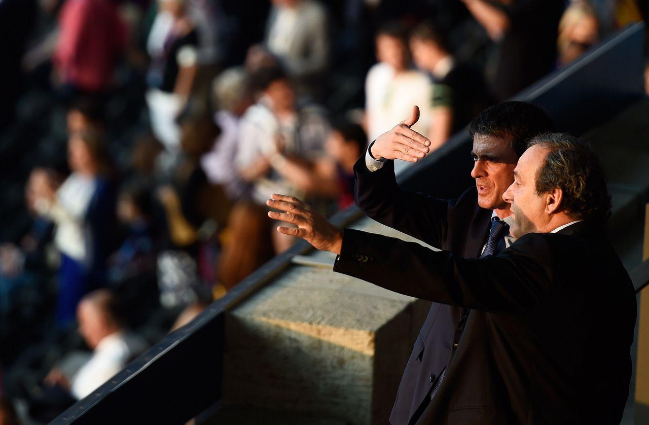 De Franse premier Manuel Valls en UEFA-voorzitter Michel Platini voorafgaand aan de finale van de Champions League, 6 juni in Berlijn.