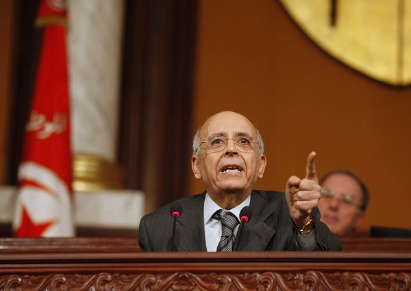 Tunisia's Prime Minister Mohamed Ghannouchi speaks at the National Assembly in Tunis in this February 7, 2011 file photo. Ghannouchi announced his resignation on February 27, 2011, over state television, following a wave of street protests. Picture taken February 7, 2011. REUTERS/Zoubier Souissi/Files (TUNISIA - Tags: POLITICS CIVIL UNREST)