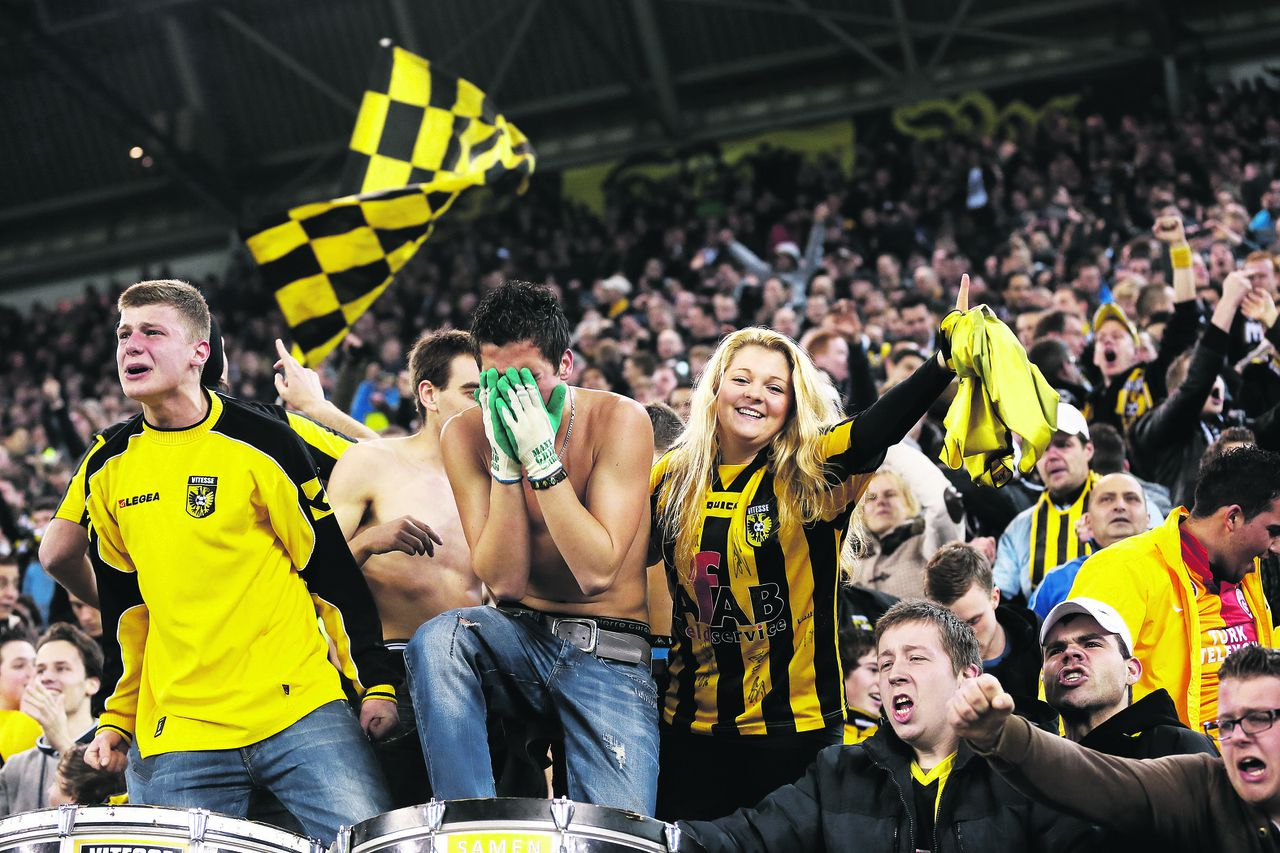 Onderwerp/Subject: Vitesse - Eredivisie Reklame: Club/Team/Country: Seizoen/Season: 2012/2013 FOTO/PHOTO: Supporters of Vitesse celebrating. (Photo by PICS UNITED) Trefwoorden/Keywords: #02 #11 #21 $38 ±1354626110271 Photo- & Copyrights © PICS UNITED P.O. Box 7164 - 5605 BE EINDHOVEN (THE NETHERLANDS) Phone +31 (0)40 296 28 00 Fax +31 (0) 40 248 47 43 http://www.pics-united.com e-mail : sales@pics-united.com (If you would like to raise any issues regarding any aspects of products / service of PICS UNITED) or e-mail : sales@pics-united.com ATTENTIE: Publicatie ook bij aanbieding door derden is slechts toegestaan na verkregen toestemming van Pics United. VOLLEDIGE NAAMSVERMELDING IS VERPLICHT! (© PICS UNITED/Naam Fotograaf, zie veld 4 van de bestandsinfo 'credits') ATTENTION: © Pics United. Reproduction/publication of this photo by any parties is only permitted after authorisation is sought and obtained from PICS UNITED- THE NETHERLANDS