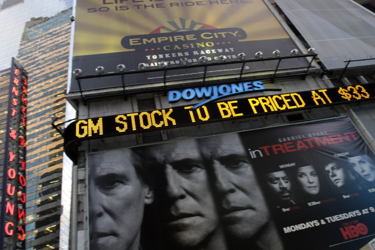 The Dow Jones ticker in New York's Times Square displays news about General Motors stock, Wednesday, Nov. 17, 2010 in New York. GM will be reborn as a public company Thursday with a stock offering, ending the government's role as majority stakeholder and closing a remarkable chapter in American corporate history. (AP Photo/Mary Altaffer)