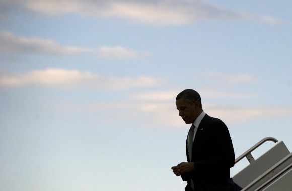 US President Barack Obama walks down the steps of Air Force One upon arrival at Andrews Air Force Base in Maryland, June 14, 2011. Obama travelled to Puerto Rico, the first visit by a US President since President John F. Kennedy's visit in 1961. AFP PHOTO / Saul LOEB