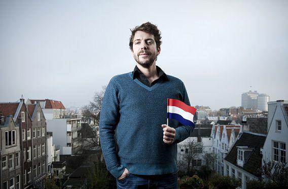 Nederland, Amsterdam, 15-11-2011 Dichter des vaderlands Ramsey Nasr tevens acteur, schrijver en performer, met de Nederlandse vlag. Van de eerste twee jaar dat hij dichter des vaderlands is is een bundel verschenen met de titel: Mijn nieuwe vaderland. foto: Bram Budel