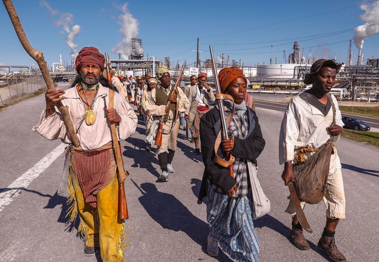 Photo of Dread Scott's Slave Rebellion Reenactment, a performance about the march in 1811 of several hundred enslaved people in New Orleans, who wanted to establish an autonomous state.