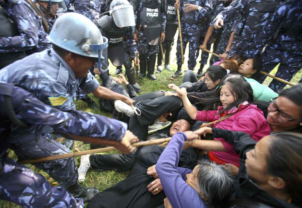 Tibetans clash with the Nepalese police during a protest in Kathmandu November 1, 2011. About 20,000 Tibetans live in Nepal with valid refugee papers, while many are believed to be residing illegally. With China's influence over Nepal increasing, the Nepalese government's stands strong against Tibetans exiles whose protests in support of their homeland has increased in recent years. Nepal ceased issuing refugee papers to Tibetans in 1989 and recognizes Tibet to be a part of China. REUTERS/Navesh Chitrakar (NEPAL - Tags: POLITICS CIVIL UNREST)