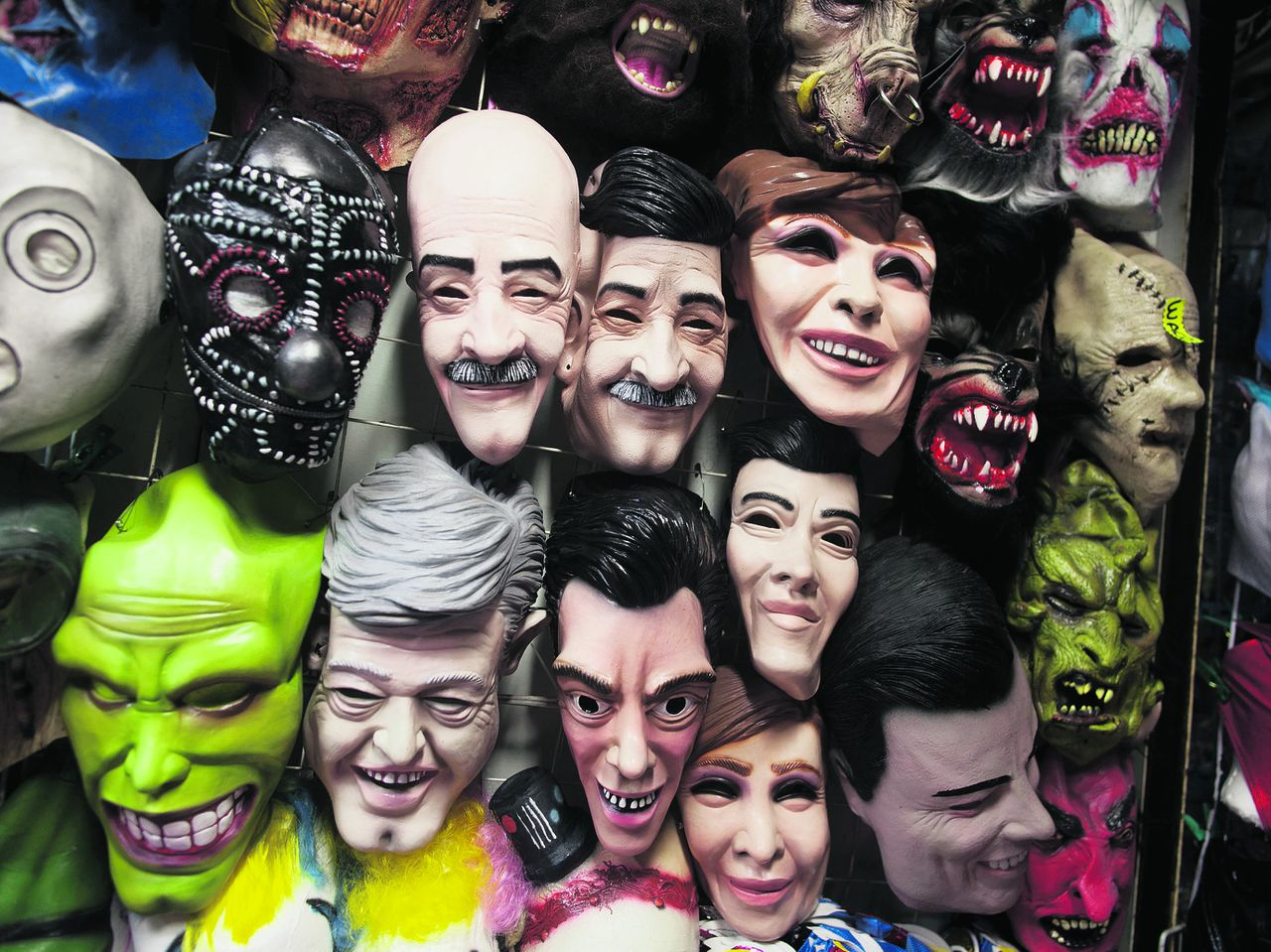 Masks depicting presidential candidates, Josefina Vazquez Mota, for the National Action Party (PAN), Enrique Pena Nieto, for the opposition Institutional Revolutionary Party, (PRI), Andres Manuel Lopez Obrador, for the Democratic Revolution Party (PRD) and former Mexico's Presidents Carlos Salina de Gortari and Vicente Fox, are displayed for sale among masks depicting some fictional characters in Mexico City, Thursday, June 28, 2012. Mexico will hold its presidential election on July 1. (AP Photo/Esteban Felix)`