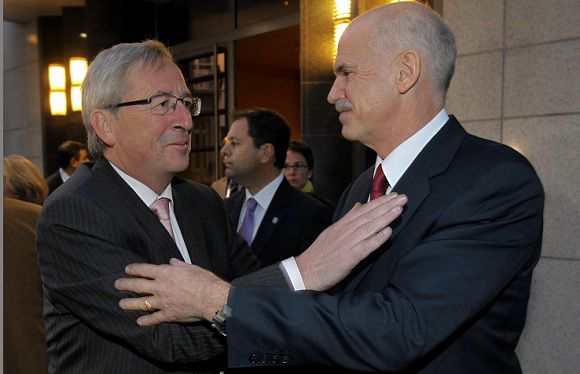 Caption: Luxembourg's Prime Minister and Eurogroup chairman Jean-Claude Juncker (L) and Greece's Prime Minister George Papandreou great each others at the end of a meeting in Brussels October 13, 2011. REUTERS/Thierry Roge (BELGIUM - Tags: POLITICS BUSINESS)