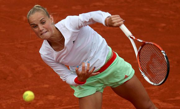 Caption: Arantxa Rus of the Netherlands serves to Kaia Kanepi of Estonia during the French Open tennis tournament at the Roland Garros stadium in Paris June 4, 2012. REUTERS/Nir Elias (FRANCE - Tags: SPORT TENNIS)
