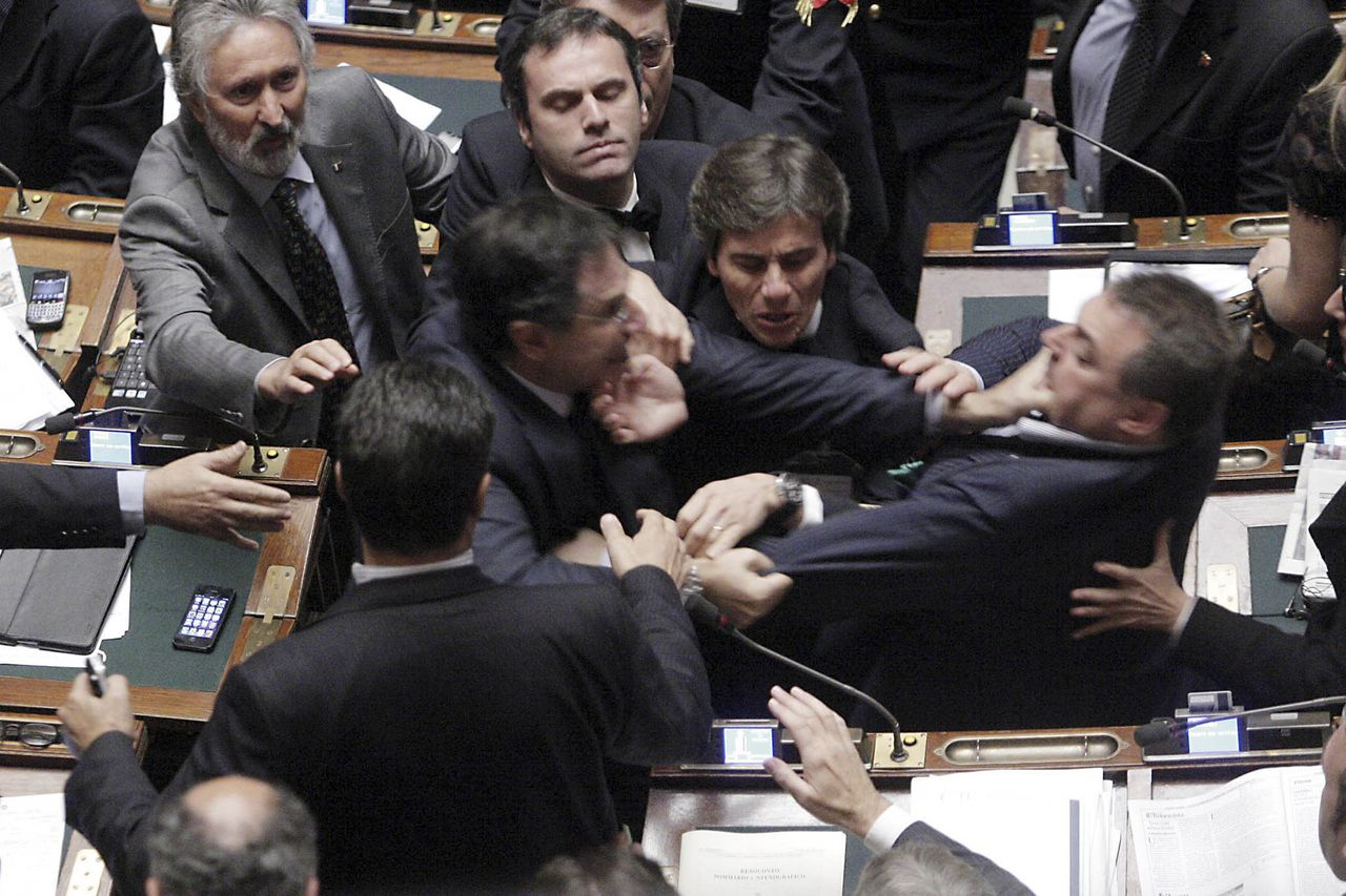 Claudio Barbato (L), a member of the opposition FLI party, fights with Fabio Ranieri (R) from the Northern League in Parliament in Rome October 26, 2011. The Italian deputies exchanged blows in parliament on Wednesday as tensions over a tough economic reform programme came to a head. REUTERS/Ansa/Giuseppe Lami (ITALY - Tags: POLITICS TPX IMAGES OF THE DAY) FOR EDITORIAL USE ONLY. NOT FOR SALE FOR MARKETING OR ADVERTISING CAMPAIGNS. THIS IMAGE HAS BEEN SUPPLIED BY A THIRD PARTY. IT IS DISTRIBUTED, EXACTLY AS RECEIVED BY REUTERS, AS A SERVICE TO CLIENTS. ITALY OUT. NO COMMERCIAL OR EDITORIAL SALES IN ITALY