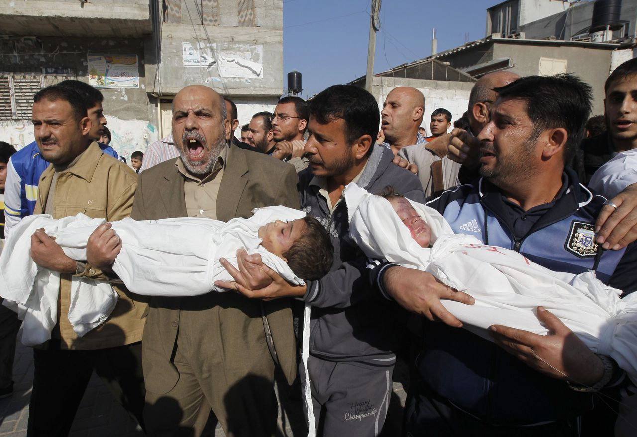 Palestinians carry the bodies of brothers Suhiab, 2-years-old, and Mohammed Hejazi, 4-years-old, during their funeral in the northern Gaza Strip area of Biet Lahia, on November 20, 2012. Four members of the Hejazi family were killed in the Israeli air strike in Gaza, the Hamas Health Ministry said. AFP PHOTO/MOHAMMED ABED
