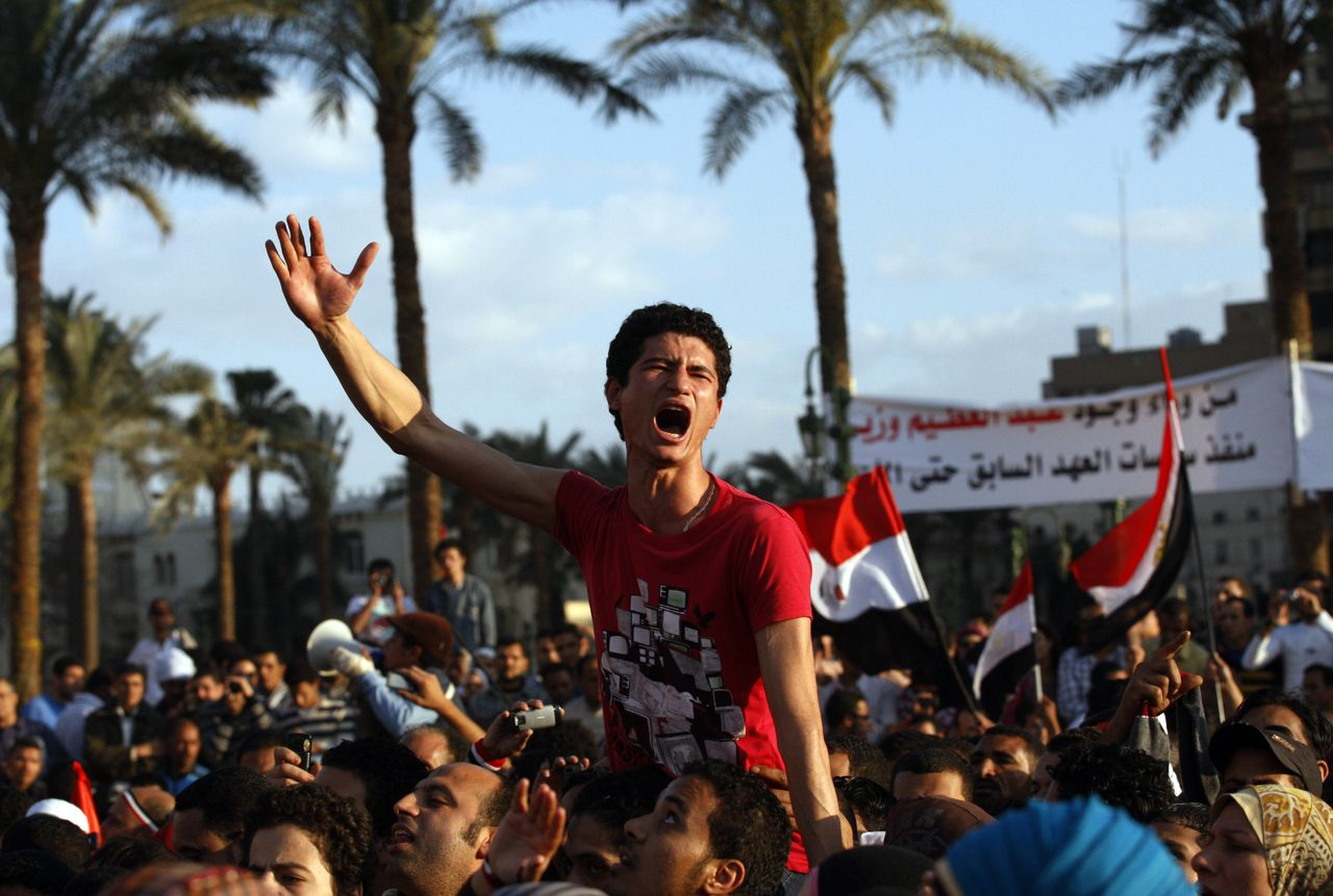 Protesters chant slogans as they march following an attack by security forces in Tahrir Square, in Cairo, Egypt, Saturday, April 9, 2011. Demonstrators burned cars and barricaded themselves with barbed wire inside a central Cairo square demanding the resignation of the military's head after troops violently dispersed an overnight protest killing one and injuring scores. (AP Photo/Khalil Hamra)