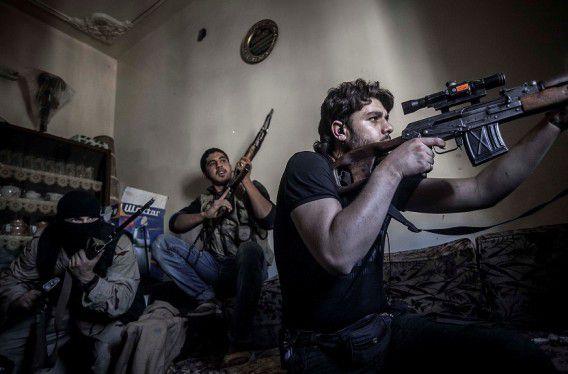 Syrische opstandelingen tijdens gevechten in Aleppo.