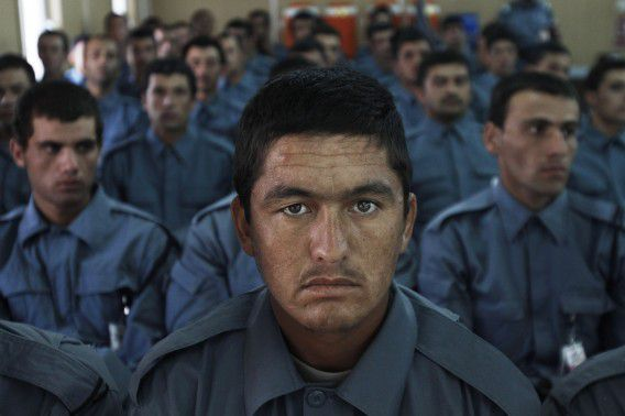 Afghan national police officers attend their graduation ceremony at a National Police training center in Jalalabad, east of Kabul, Afghanistan, Thursday, August 30, 2012. Over 141 National police officers graduated after receiving 2 months of training in Jalalabad. (AP Photo/Rahmat Gul)