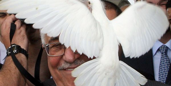 TOPSHOTS The President of the Palestinian National Authority, Mahmoud Abbas, releases a dove during the ceremony to lay the cornerstone for a a Palestine Embassy in Brasilia, Brazil on December 31, 2010. Abbas is in Brazil to attend the inauguration of President-elect Dilma Rousseff on January 1, 2011, reflecting Brazil's decision this month to recognize a Palestinian state -- a decision since followed by Argentina, Bolivia and Uruguay. TOPSHOTS / AFP PHOTO / Adriano MACHADO