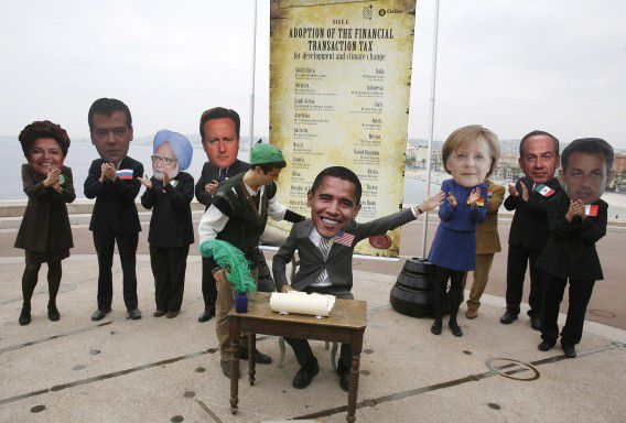 Oxam, activists wearing masks , left to right, of Brazilian President Dilma Rousseff , Russian President Dmitry Medvedev, Indian Prime Minister, Dr. Manmohan Singh, Britain's Prime Minister David Cameron, unidentified unmasked Oxfam activist, US president Barack Obama, German Chancellor Angela Merkel, President of Mexico Felipe Calderon, and French President Nicolas Sarkozy, during a demonstration in Nice, southeastern France, against G20 summit of Cannes, Wednesday, Nov. 2, 2011.(AP Photo/Lionel Cironneau)