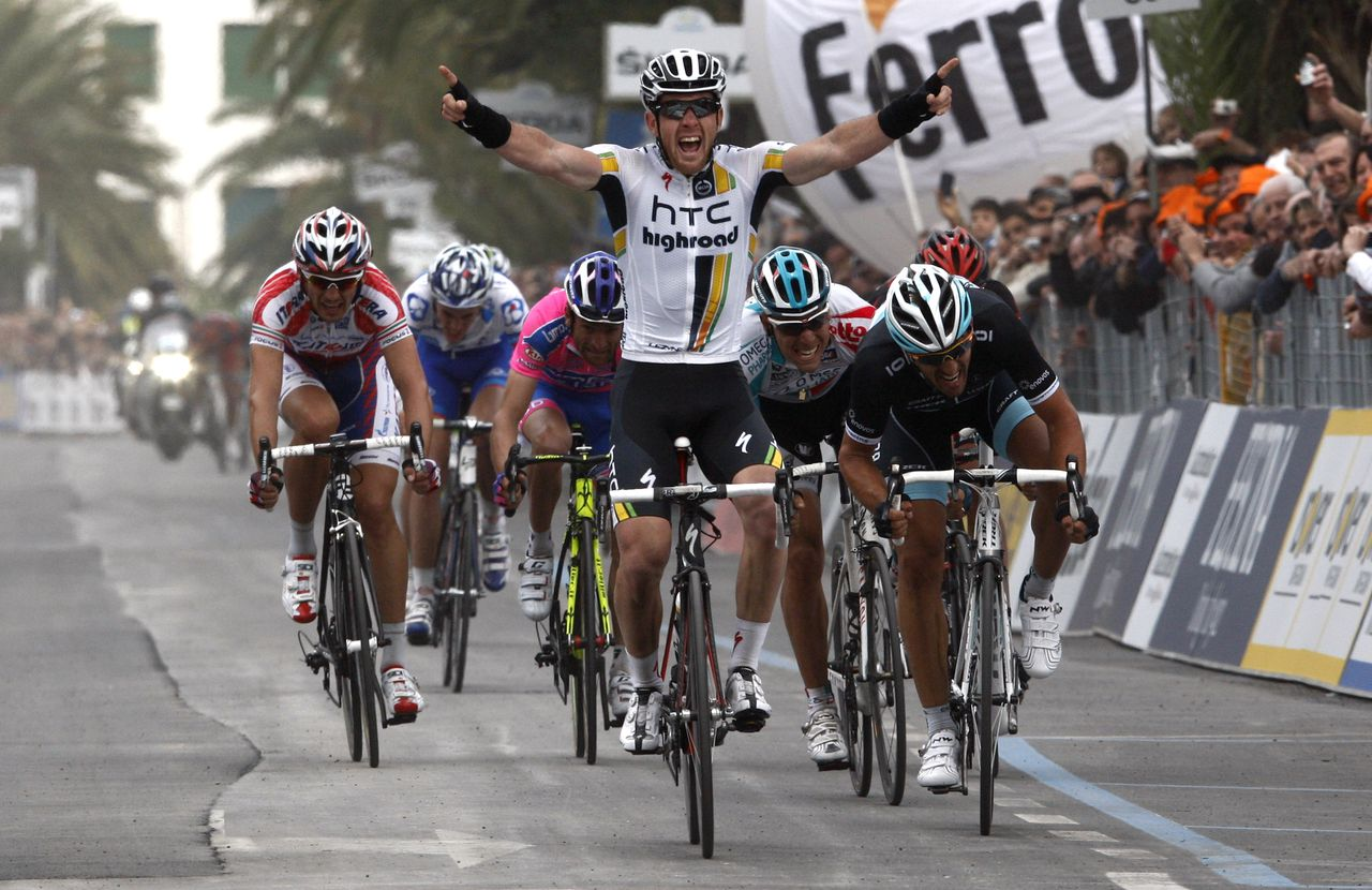 Australian Matthew Goss (C) of the HTC-Highroad team crosses the finish line and wins the the 102th edition of the Milan-Sanremo race on March 19, 2011 in San Remo. Fabian Cancellara of Switzerland placed second, Belgian Philippe Gilbert of Omega-Pharma finishing third. AFP PHOTO/Luk Beines