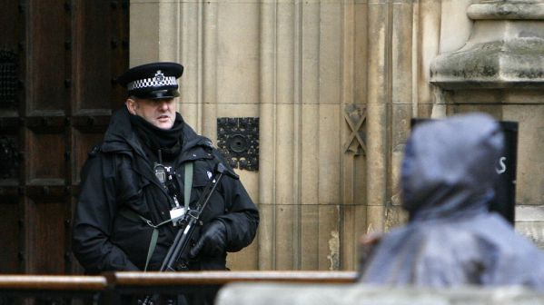 A British armed police officer talks with an unidentified visitor outside the Houses of Parliament in London, Tuesday, Oct. 26, 2010. British police are training with military experts to prepare for Mumbai-style gun attacks by terrorists, the country's interior ministry said Tuesday. (AP Photo/Akira Suemori)