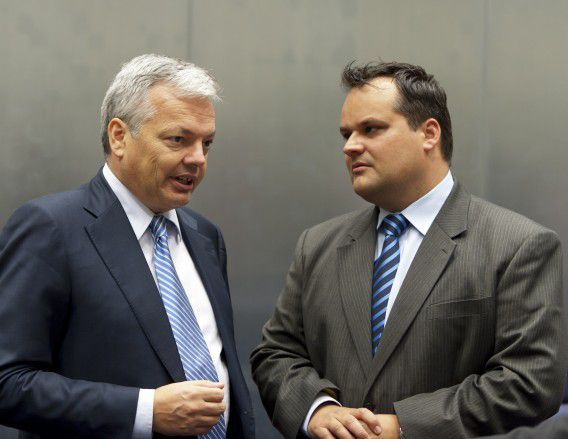 Belgian Finance minister Didier Reynders(L) speaks with his Dutch counterpart Dutch Finance Minister Jan Kees de Jager prior to an Eurogroup council meeting on October 3, 20101 at EU Headquarters in Luxembourg. AFP PHOTO / JEAN-CHRISTOPHE VERHAEGEN