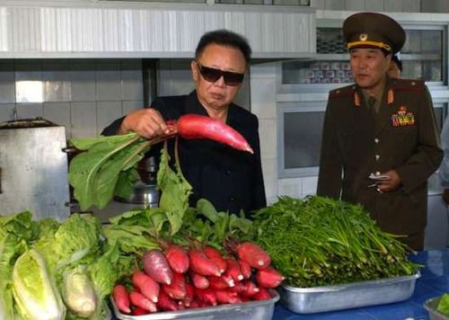 Kim Jong-Il hanging out with a giant radish. [Photo: AFP