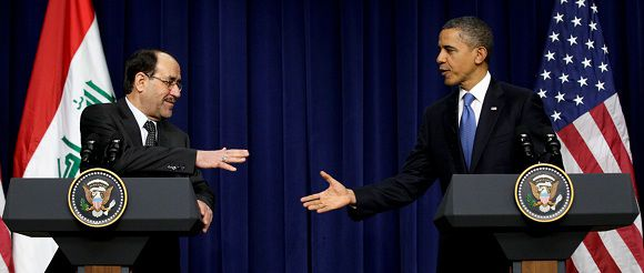 Caption: President Barack Obama and Iraq's Prime Minister Nouri al-Maliki shake hands in the South Court Auditorium at the White House in Washington, Monday, Dec. 12, 2011. (AP Photo/Carolyn Kaster)