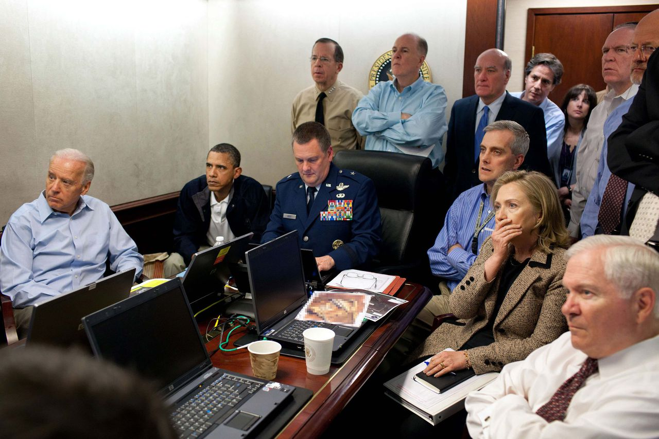 U.S. President Barack Obama (2nd L) and Vice President Joe Biden (L), along with members of the national security team, receive an update on the mission against Osama bin Laden in the Situation Room of the White House, May 1, 2011. Also pictured are Secretary of State Hillary Clinton (2nd R) and Defense Secretary Robert Gates (R). Please note: A classified document seen in this photograph has been obscured at source. Picture taken May 1, 2011. REUTERS/White House/Pete Souza/Handout (UNITED STATES - Tags: POLITICS CIVIL UNREST MILITARY IMAGES OF THE DAY) FOR EDITORIAL USE ONLY. NOT FOR SALE FOR MARKETING OR ADVERTISING CAMPAIGNS. THIS IMAGE HAS BEEN SUPPLIED BY A THIRD PARTY. IT IS DISTRIBUTED, EXACTLY AS RECEIVED BY REUTERS, AS A SERVICE TO CLIENTS