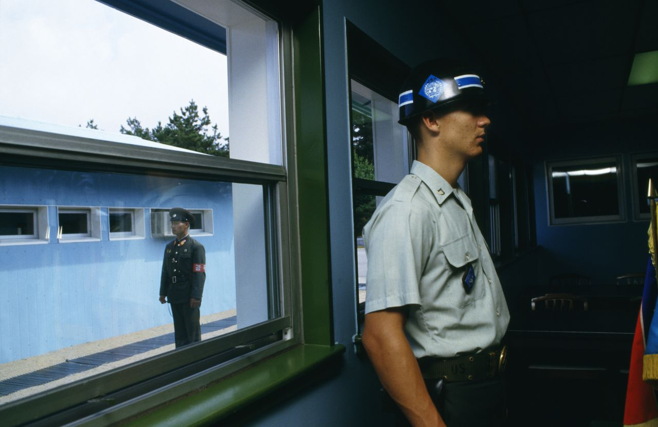 05 Jul 1987 --- Guards stand at attention at the border between South and North Korea. | Location: Border of South Korea and North Korea. --- Image by © Patrick Robert/Sygma/CORBIS