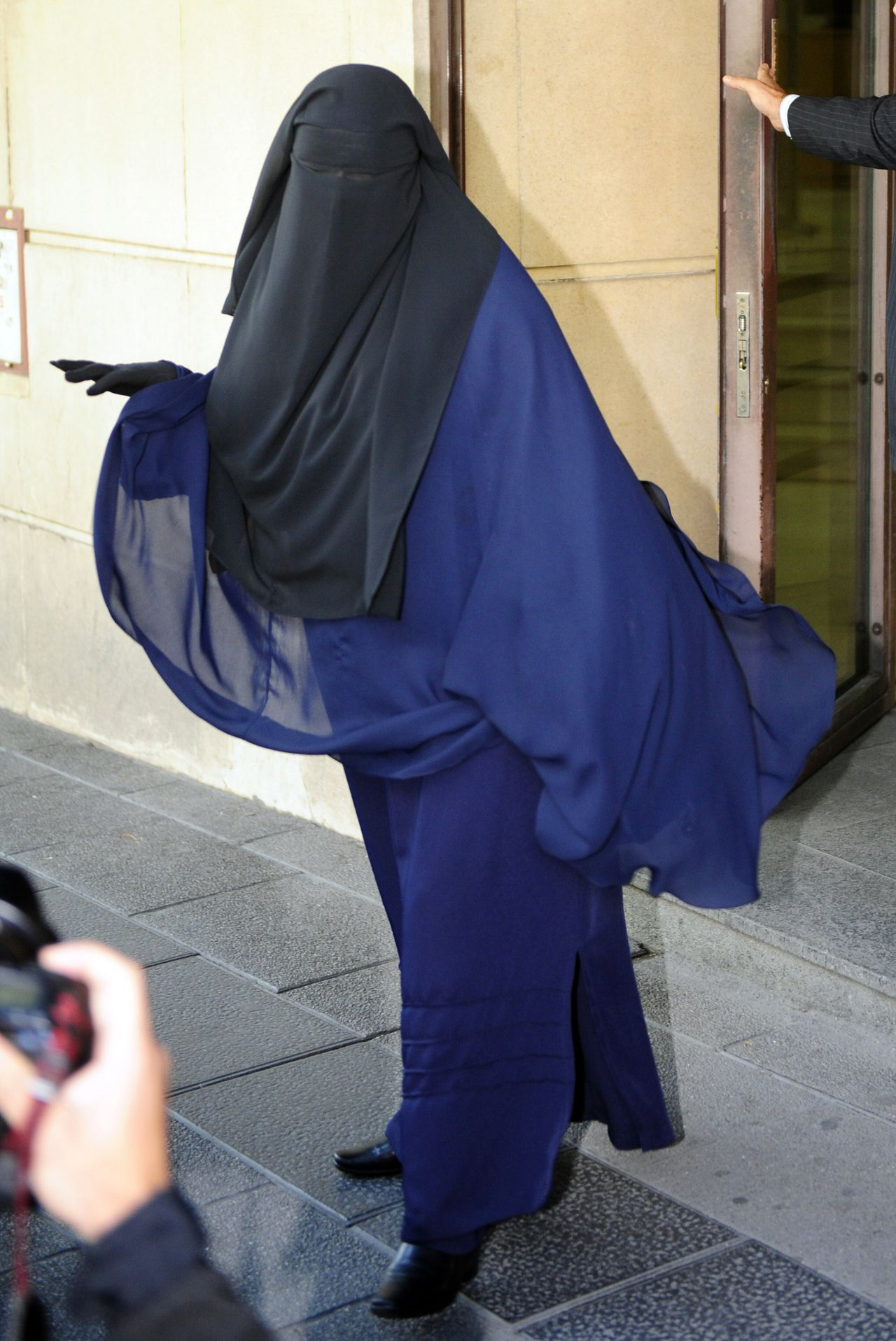 TO GO WITH AFP STORY BY PIERRE AUSSEILL(FILES) A file photo taken on September 28, 2009 shows Fatima Hssisni, a fully veiled Muslim woman, leaving the high court after testifying in a trial against a radical Islamic cell in Madrid. Hssisni, who was expelled from court after refusing to testify bareface as the Spanish law dictates, was able to testify lifting her veil toward the judge but back to the public. After France and Belgium, the debate on banning the full Islamic veil is reaching Spain, where local bans are becoming more frequent. The Catalonian Regional Parliament should decide on June 30, 2010 whether to ban the full Islamic veil (burqa or niqab) in public places AFP PHOTO / DOMINIQUE FAGET
