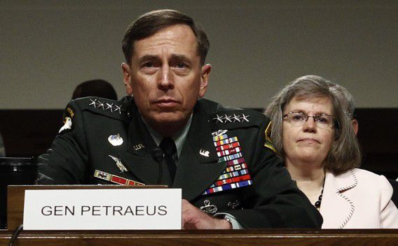 """U.S. General David Petraeus, with his wife Holly seated behind him, testifies at his Senate Armed Services Committee confirmation hearing to become commander of U.S. forces in Afghanistan on Capitol Hill in this June 29, 2010 file photo. The scandal that felled CIA Director Petraeus widened on November 13, 2012, to snare the top U.S. commander in Afghanistan, Marine General John Allen, who was being investigated for """"flirtatious"""" communications with a woman at the center of the case. REUTERS/Kevin Lamarque/Files (UNITED STATES - Tags: MILITARY)"""