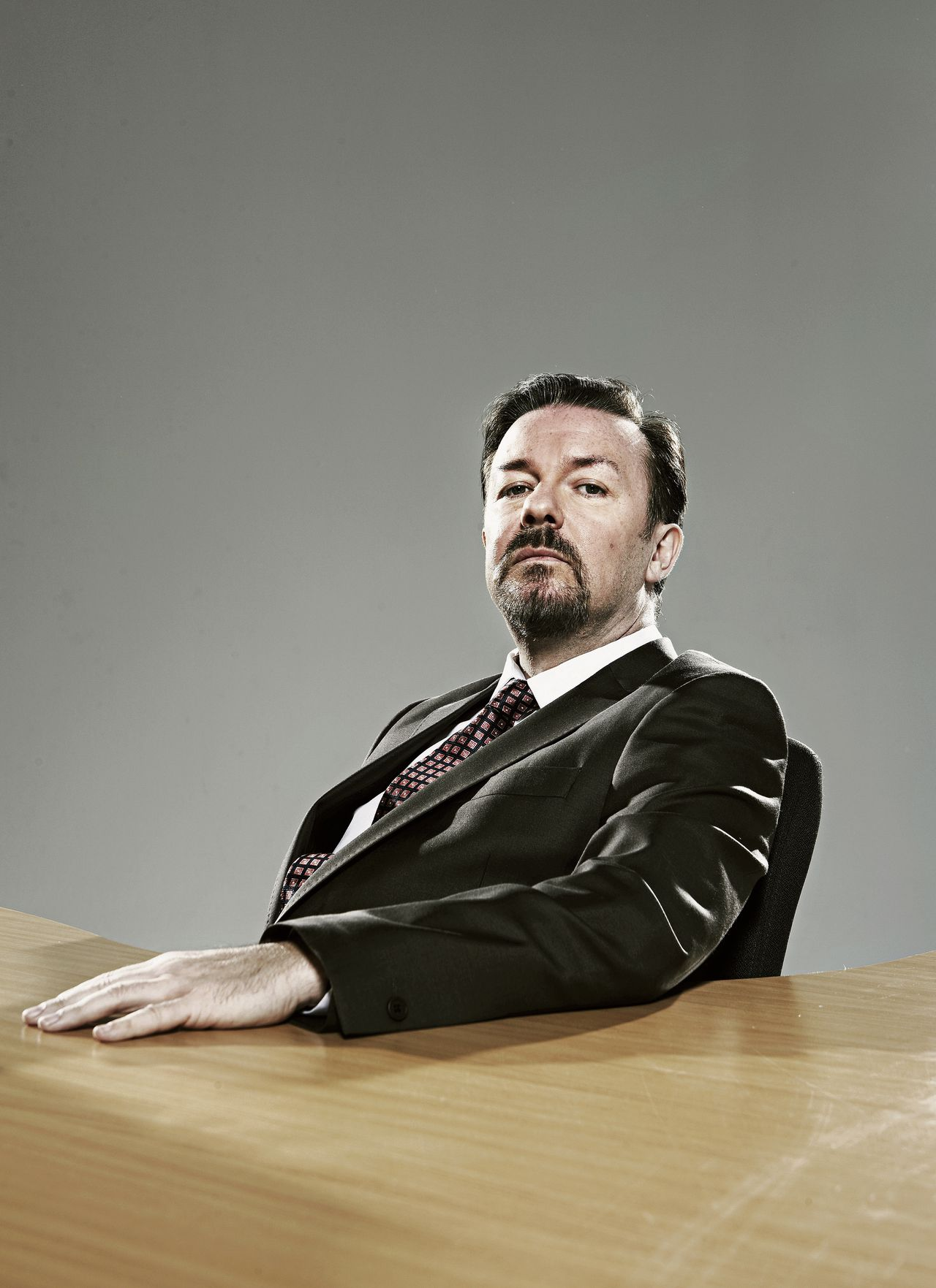 Ricky Gervais speelt David Brent, een boss from hell, in de BBC-comedyserie The Office.