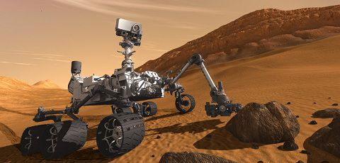 Caption: FILE - In this 2011 artist's rendering provided by NASA/JPL-Caltech, the Mars Science Laboratory Curiosity rover examines a rock on Mars with a set of tools at the end of its arm, which extends about 2 meters (7 feet). The mobile robot is designed to investigate Mars' past or present ability to sustain microbial life. Curiosity is set to land in a crater near the Martian equator in August 2012 to begin a two-year mission. (AP Photo/NASA/JPL-Caltech,File)