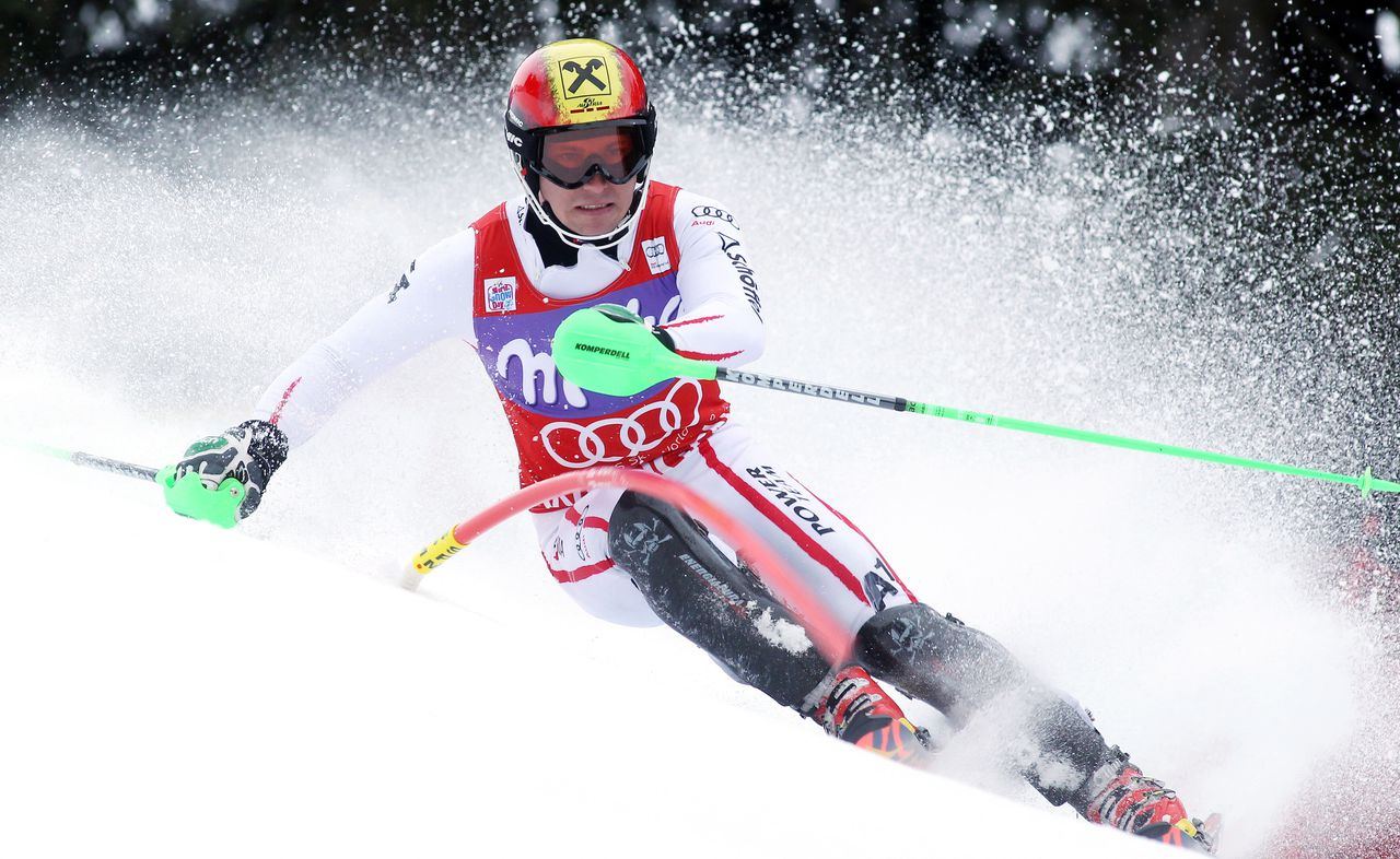 Austria's Marcel Hirscher speeds past a pole on his way to clock the fastest time in the first run of an Alpine ski World Cup men's slalom, in Wengen, Switzerland, Sunday, Jan. 20, 2013. (AP Photo/Alessandro Trovati)