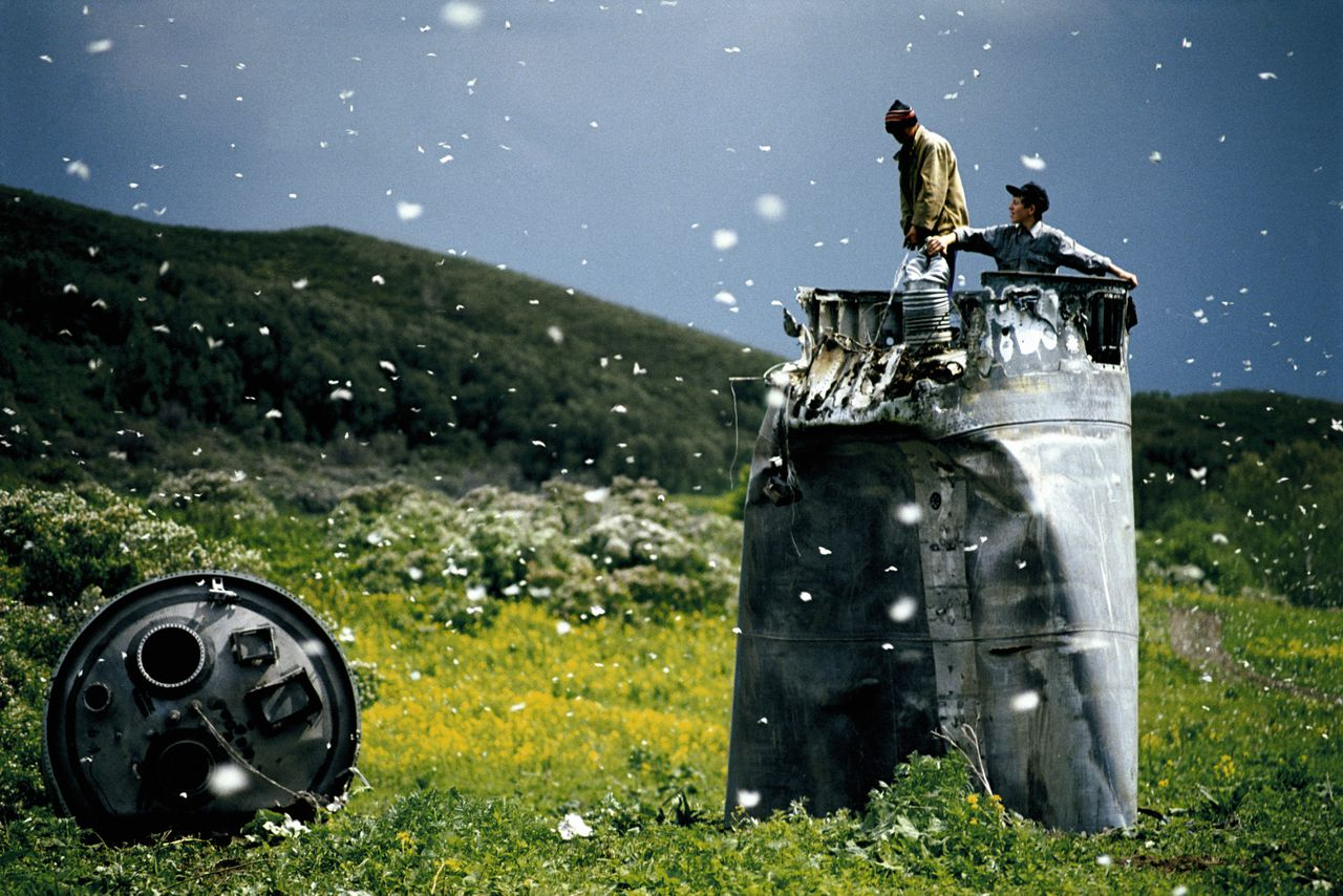 RUSSIA. Altai Territory. 2000. Villagers collecting scrap from a crashed spacecraft, surrounded by thousands of white butterflies. Environmentalists fear for the region's future due to the toxic rocket fuel. Contact email: New York : photography@magnumphotos.com Paris : magnum@magnumphotos.fr London : magnum@magnumphotos.co.uk Tokyo : tokyo@magnumphotos.co.jp Contact phones: New York : +1 212 929 6000 Paris: + 33 1 53 42 50 00 London: + 44 20 7490 1771 Tokyo: + 81 3 3219 0771 Image URL: http://www.magnumphotos.com/Archive/C.aspx?VP3=ViewBox_VPage&IID=2K7O3RJHMMHH&CT=Image&IT=ZoomImage01_VForm