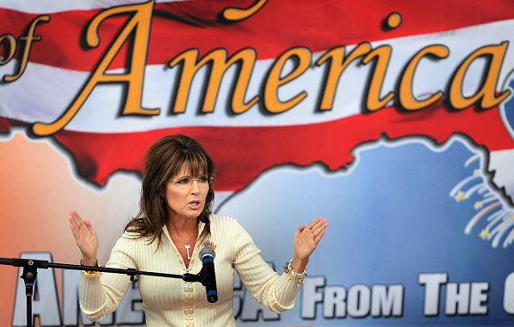 "Caption: WAUKEE, IA - SEPTEMBER 03: Former Alaska Governor Sarah Palin speaks to supporters during the Tea Party of America's ""Restoring America"" event at the Indianola Balloon Festival Grounds September 3, 2011 in Indianola, Iowa. Yesterday Palin attended a Conservatives4Palin event. She is scheduled to speak at another Tea Party event in New Hampshire on Monday. The stops continue to fuel speculation that the former governor will run for president, a decision which she said she would make by the end of September. Scott Olson/Getty Images/AFP"