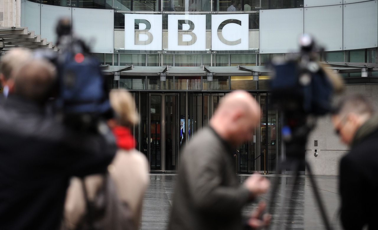 """epa03468132 Television networks outside the new BBC Broadcasting House in central London 12 November 2012. The BBC's director of news, Helen Boaden, and her deputy have """"stepped aside"""" pending the outcome of an internal review. The move by Boaden and Steve Mitchell follows director general George Entwistle's resignation last weekend. EPA/ANDY RAIN"""