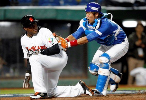 Netherlands' Andruw Jones is tagged out by South Korea's catcher Kang Minho at home base after he slides in during the fourth inning of the World Baseball Classic qualifying first round at the Taichung Intercontinental Baseball Stadium March 2, 2013. REUTERS/Pichi Chuang (TAIWAN) IPTC Date: 14:52 02/03/13