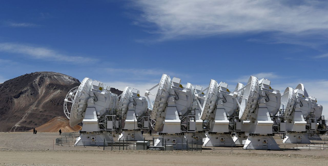 Parabolic antennas of the ALMA (Atacama Large Millimetre/Submillimetre Array) project are seen at the El Llano de Chajnantor in the Atacama desert, some 1730 km (1074 miles) north of Santiago and 5000 metres above sea level, March 12, 2013. ALMA will be inaugurated on Wednesday and is being constructed by the ESO (European Organisation for Astronomical Research in the Southern Hemisphere) with its partners NAOJ (National Astronomical Observatory of Japan) and NRAO (National Radio Astronomy Observatory). ALMA will have 66 high precision antennas which will work together as a single giant telescope to study the universe, molecular gas, dust of stars, galaxies and planetary systems, ESO said. REUTERS/Ivan Alvarado (CHILE - Tags: SCIENCE TECHNOLOGY ENVIRONMENT)