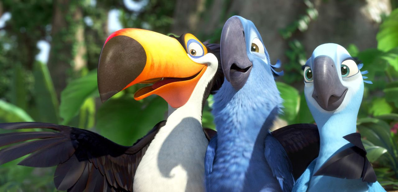 """In this publicity image released by 20th Century Fox, animated characters, from left, Raphael, voiced by George Lopez, Blu, voiced by Jesse Eisenberg, and Jewel, voiced by Anne Hathaway, are shown in a scene from """"Rio."""" (AP Photo/20th Century Fox)"""