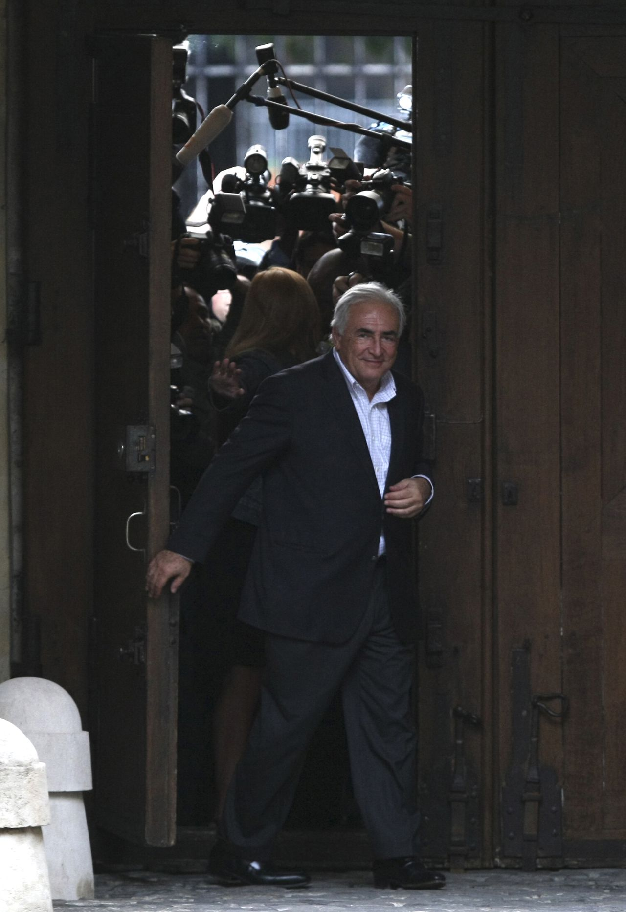 ALTERNATE CROP OF XLR111- Dominique Strauss-Kahn, former head of the International Monetary Fund, arrives in the courtyard of his home in Paris, France, Sunday, Sept. 4, 2011. Dominique Strauss-Kahn has returned home to France for the first time since a New York hotel maid accused him of attempted rape, unleashing a scandal that dashed his chances for the French presidency. (AP Photo/Claude Paris)