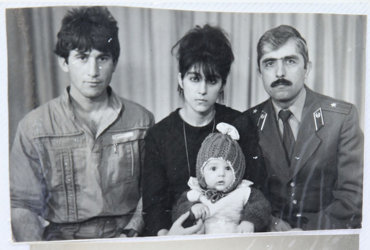 A photo, showing Tamerlan (C, bottom) Tsarnaev, accompanied by his father Anzor (L), mother Zubeidat and uncle Muhamad Suleimanov (R), is seen in this photo courtesy of the Suleimanova family in Makhachkala, April 22, 2013. Dzhokhar Tsarnaev, 19, an ethnic Chechen college student suspected of carrying out the attacks with his older brother, lay in a Boston hospital under armed guard. He was unable to speak after he was captured with throat injuries sustained during shoot-outs with police. Tamerlan Tsarnaev, 26, died after a gunfight with police early Friday morning. The badly wounded Boston Marathon bombing suspect faced federal charges as early as Monday and the city of Boston planned tributes to the dead after a week of blasts, shootouts, lockdowns and one of the largest manhunts in U.S. history. REUTERS/Courtesy of Suleimanova family/Handout (RUSSIA - Tags: CRIME LAW) FOR EDITORIAL USE ONLY. NOT FOR SALE FOR MARKETING OR ADVERTISING CAMPAIGNS