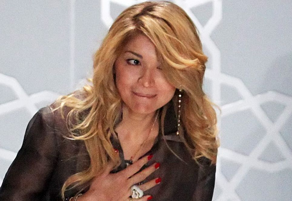2011-04-02 17:49:51 epa02666831 Gulnara Karimova (C), daughter of Uzbek President Uzbek President Islam Karimov, takes the applause after showing her brand GULI at the Mercedes-Benz Fashion Week Russia Fall-Winter 2011/12, in Moscow, Russia, 02 April 2011. Gulnara Karimova is a Doctor of political science, professor. Currently serves as Ambassador Extraordinary and Plenipotentiary of Uzbekistan to Spain and Permanent Representative of Uzbekistan to the United Nations Office and other International Organizations in Geneva. EPA/SERGEI ILNITSKY