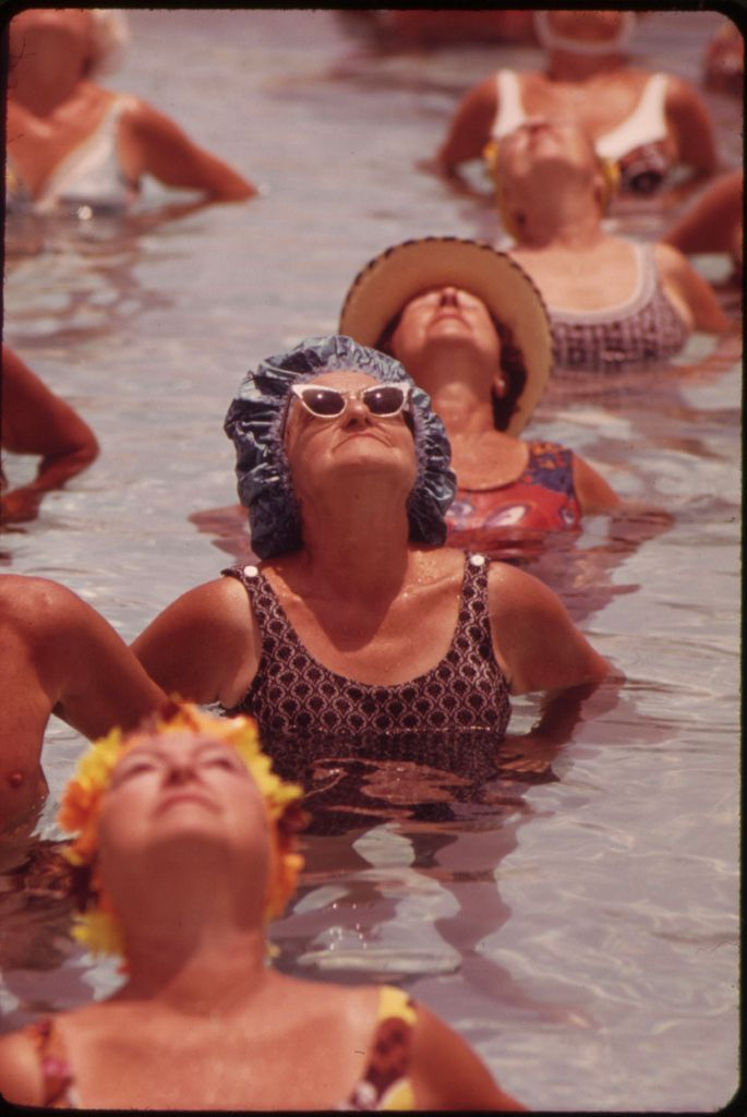 In this undated photo provided by the U.S. National Archives, residents take part in an aquatic exercise class at the Century Village Retirement Community in West Palm Beach, Fla. The photo is part of Documerica, an EPA project during the 1970s in which the agency hired dozens of freelance photographers to capture thousands of images related to the environment and everyday life in America. Modeled after Documerica, the agency has embarked on a massive effort to collect photographs from across the United States and around the world over the next year that depict everything from nature's beauty to humanity's impact, both good and bad. (AP Photo/U.S. National Archives, Flip Schulke)