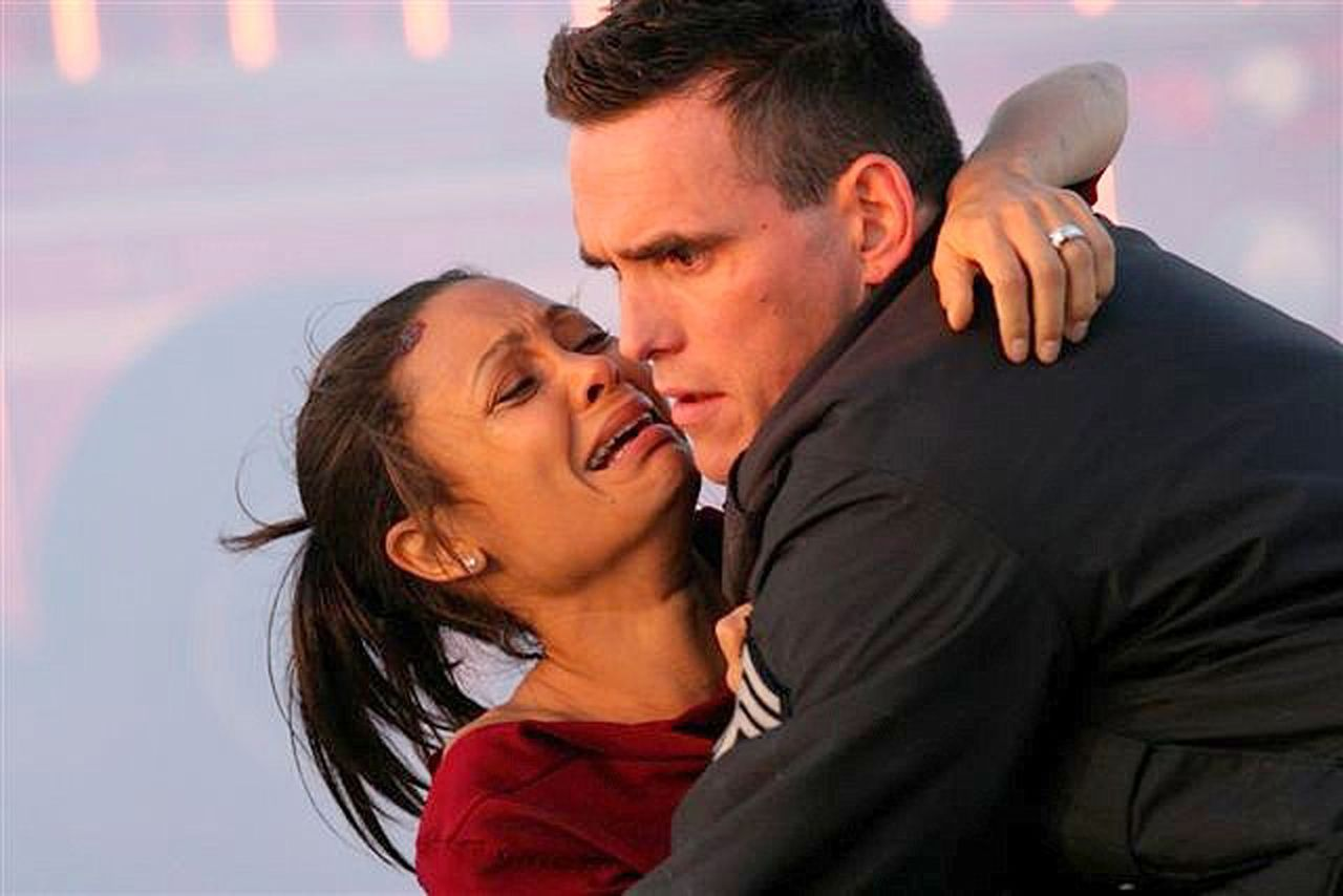"""Actress Thandie Newton (L) and actor Matt Dillon, two members of the ensemble cast of the drama film """"Crash"""" are shown in this undated publicity photograph. """"Crash"""" received a best picture nomination for the upcoming 78th Academy Awards. The nominations were announced in Beverly Hills, California January 31, 2006, and the Oscars will be presented March 5, 2006. NO SALES NO ARCHIVES REUTERS/Lions Gate Films/Handout"""
