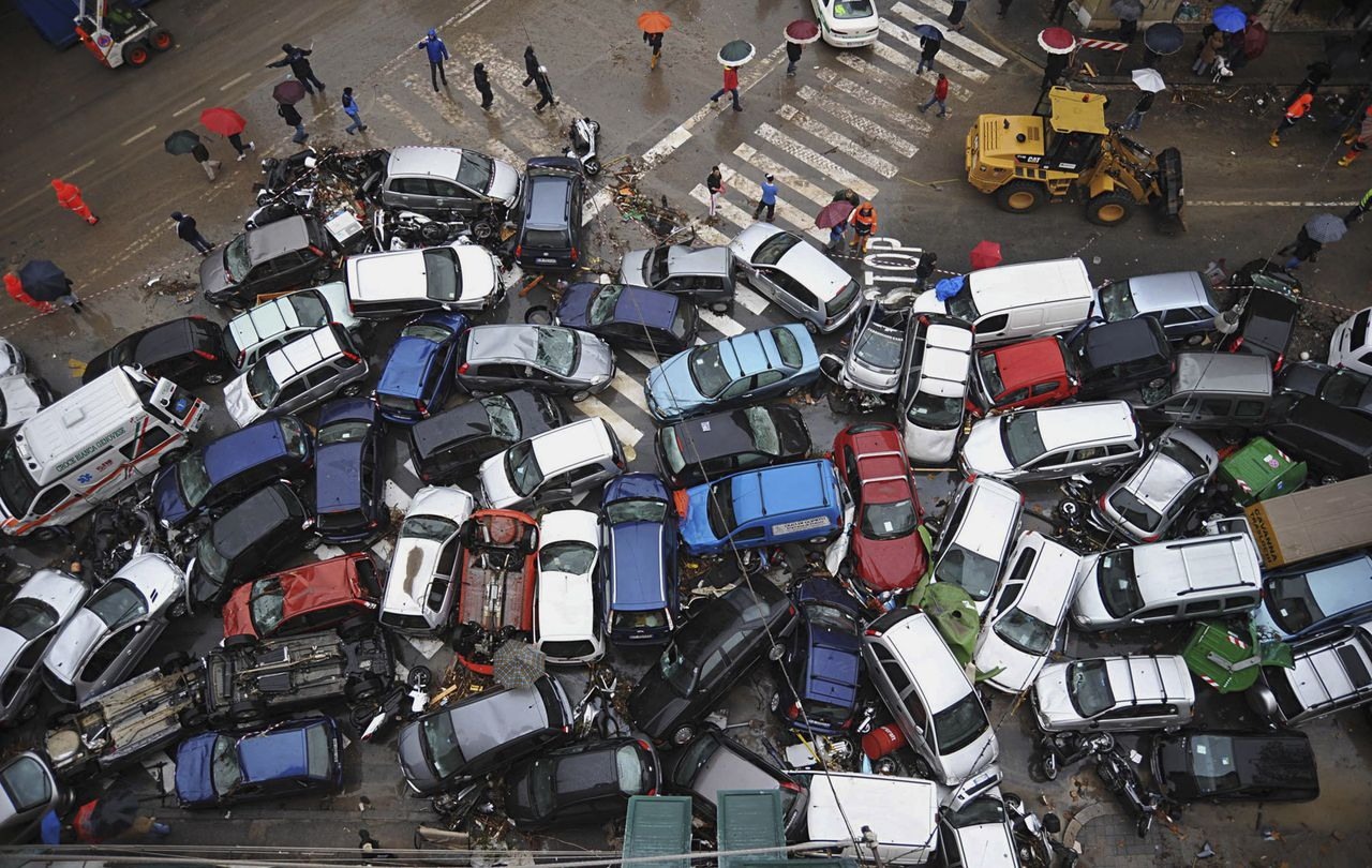 Cars, some overturned, that were swept into a pile by Friday's torrential rains are seen on a street in Genoa, Italy Saturday, Nov. 5, 2011. Italy's Premier Silvio Berlusconi says improper construction in flood plains was partly to blame for devastating floods that have killed at least six people in the port city of Genoa. Torrential rains lashing Genoa and Italy's western coast on Friday triggered flash floods that broke the banks of at least two rivers. (AP Photo/Matteo Corner, LaPresse) ITALY OUT