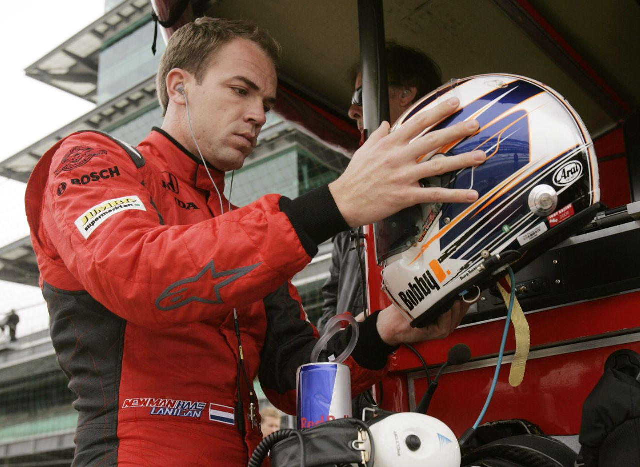 Newman Haas Lanigan Racing driver Robert Doornbos of the Netherlands inspects his helmet during practice at the Indianapolis Motor Speedway in Indianapolis May 7, 2009. Qualifications for the Indianapolis 500 on May 24 begin May 9. REUTERS/Brent Smith (UNITED STATES SPORT MOTOR RACING)