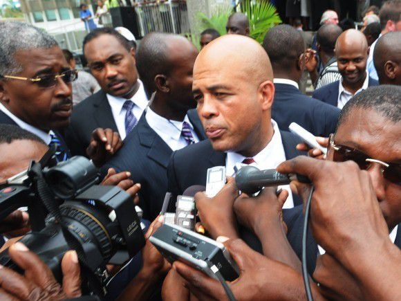 Haitian President Michel Martelly speaks to the media as he arrives at a press conference to join Former US President Bill Clinton, to announce a 30 million USD donation from the Foundation for the Reconstruction of Haiti on August 17, 2011 in Port-au-Prince. Haiti continues reconstruction efforts following the January 12, 2010, earthquake. AFP PHOTO/Thony BELIZAIRE