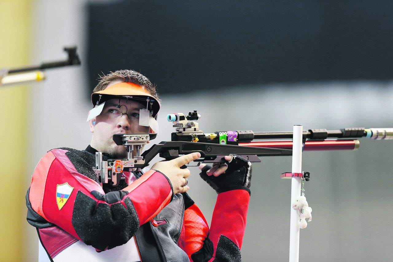 Netherlands' Peter Hellenbrand prepares to shoot during the final for the men's 10-meter air rifle at the 2012 Summer Olympics, Monday, July 30, 2012, in London. (AP Photo/Rebecca Blackwell)